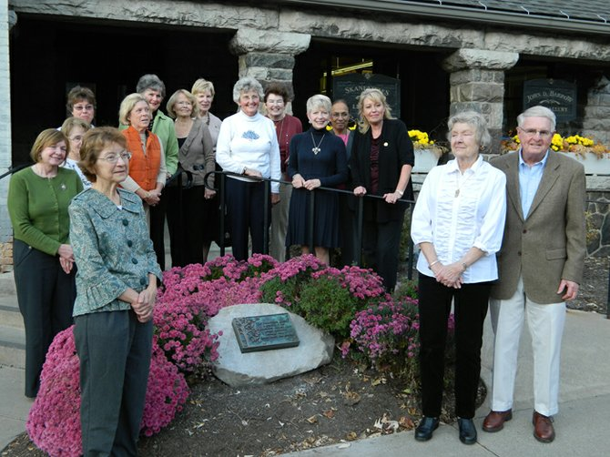 Members of the Skaneateles Garden Club pose alongside their new plaque with Richard H. Bennett of the Library Association.