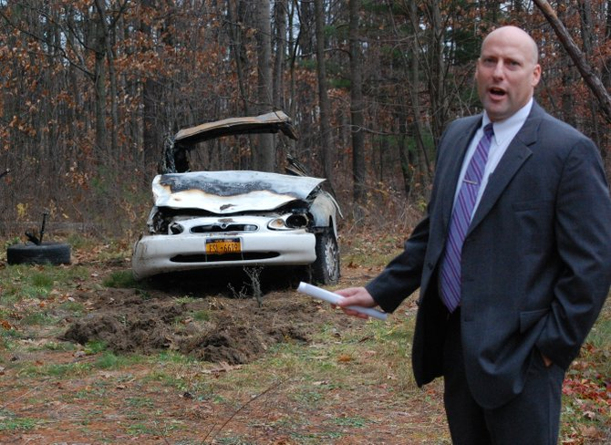 State Police Lt. Brent Davison discusses the wreckage following a Nov. 15 accident that claimed the lives of four teenagers.
