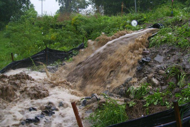 Water runs through Rob Breen's property in Clarksville during Tropical Storm Irene. Breen has helped to organize a community meeting Nov. 30 for area residents interested in discussing flooding concerns.