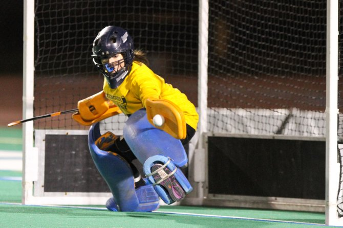 Cazenovia goalie Lauren Devine stops the penalty stroke taken by Bronxville's Brooke Bonfiglio in Saturday's state Class C semifinal, a key moment in the Lakers' 1-0 win over the Broncos at Cicero-North Syracuse's Bragman Stadium.