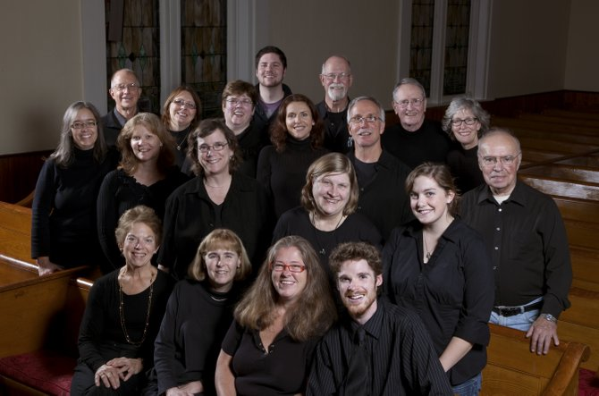 The Northern Adirondack Vocal Ensemble, led by conductor Andrew Benware, front row, far right, is the latest offering by Hill and Hollow Music, a nonprofit organization based in the town of Saranac.