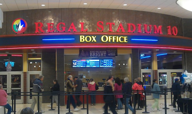 Moviegoers head to the new Regal Clifton Park Cinemas during the grand opening events.