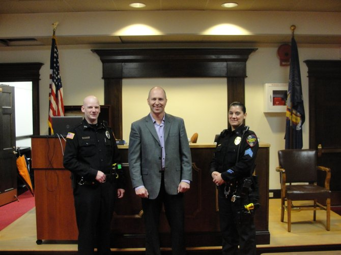 President of SecureIt Tactical Inc. Tom Kubinec, center, is flanked by Officer James Kazmirski and Sergeant Karen Zaleski, Nov. 16 in the Municipal Building. Kubinec donated $1,400 to the Police Benevolent Association for the purchase of a second taser for the Cazenovia Police Department.