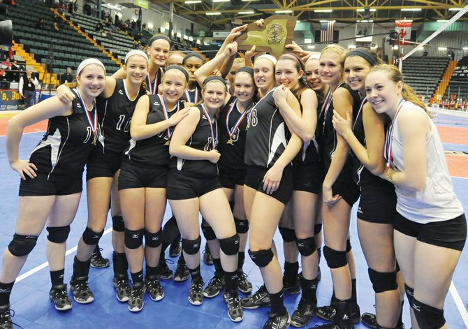 The Burnt Hills-Ballston Lake girls volleyball team celebrates after beating Mercy (Section V) 3-1 in Sunday's Class A final at the state tournament in Glens Falls.