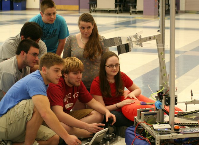 Members of the Ballston Spa High School robotics team pose with one of the newest creations, Rosie the robot. 