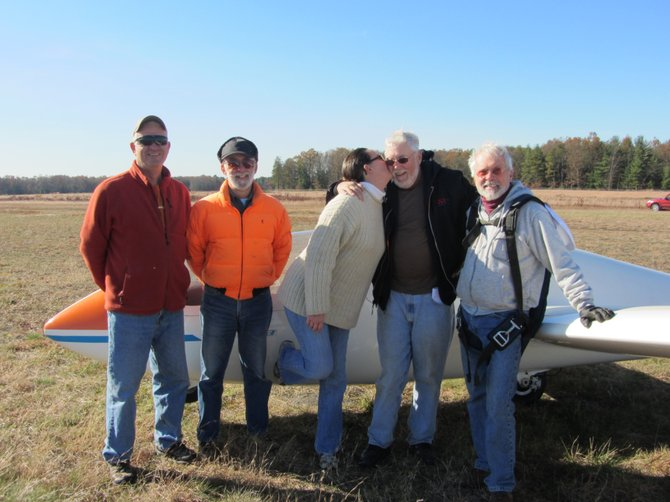 Saratoga Soaring Association members congratulate Dr. Robert Mitchell on earning his FAA Private Pilot (Glider) License on Friday, Nov. 4, at the Saratoga County Airport. From left, Fred Woll, tow pilot; Jim Morzillo, FAA Examiner; Pam Grandin, student pilot; Robert Mitchell; and Doug Hatch, Mitchell's endorsing instructor and mentor.