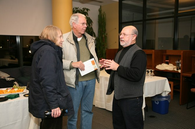 "Charles Gianfagna, far right, hosted an artist talk Friday, Nov. 18, for the grand opening of his art exhibit, ""A Retrospective,"" on display in Yates Gallery in Standish Library at Siena."