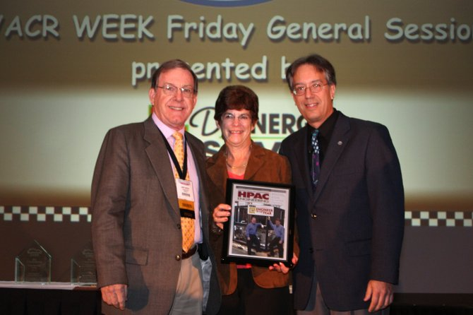 Air Innovations Chairman Larry Wetzel, left, and his wife Glenda, are given the inaugural HPAC Engineer of the Year Award by HPAC Editorial Director Mike Weil, Sept. 23 in Indianapolis, Ind.