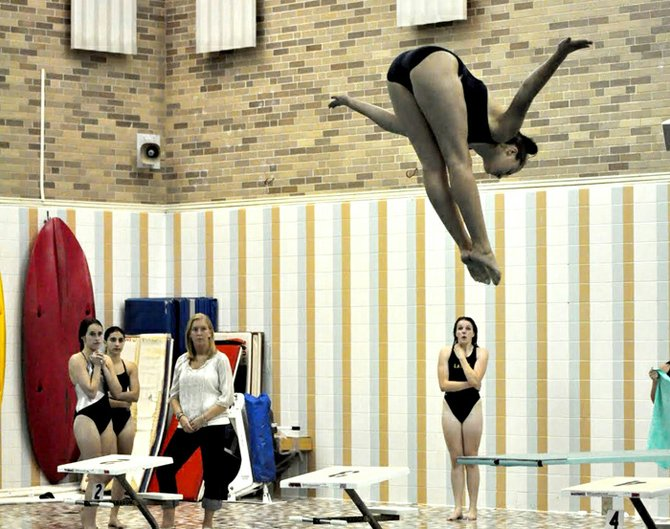 Kaela Fiutak in pike position as she dives during a team practice.