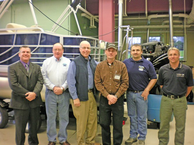 Representatives of area marinas turned out to show their support for the new Marine Academy at Ticonderoga High School. From left are Mike Graney, Ti High principal, Scott Andersen of FR Smith and Sons Marina in Bolton, Roger Phinney, executive director of the Eastern New York Marine Trades Association, Bernie Hill of EZ Marine and Storage in Brant Lake, Bob Palandrani of Snug Harbor Marina in Ticonderoga and Rich Stolen of Schroon Lake Marina and Loon Lake Marina.