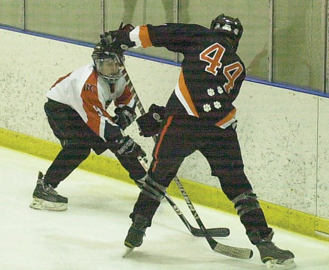 Bethlehem's Wyatt Grace, left, battles Mamaroneck's Trey Herlitz-Ferguson during Friday's opening round of the Shaker/Colonie Thanksgiving Tournament at the Albany County Hockey Facility.