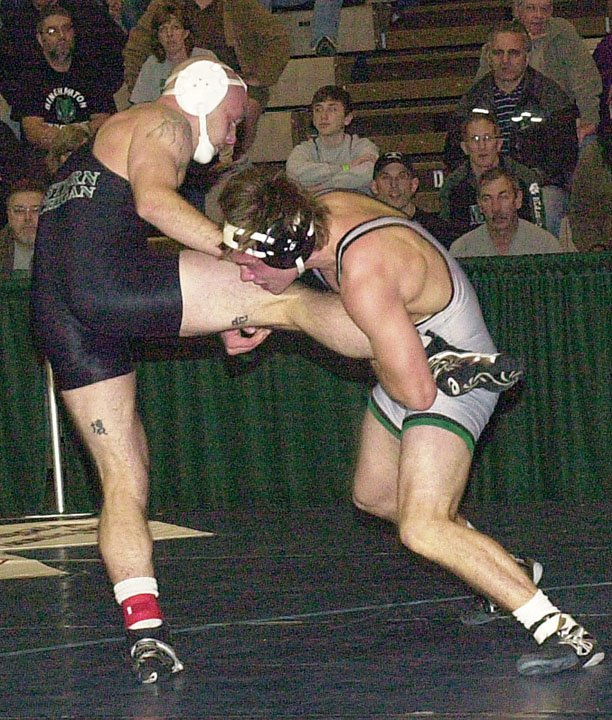 Binghamton's Matt Kaylor (right) — a Burnt Hills-Ballston Lake High School graduate — tries to complete a takedown against Eastern Michigan's Lester France during their 165-pound bout at Saturday's Journeymen/ASICS Northeast Collegiate Duals at Hudson Valley Community College in Troy. Kaylor won the match 9-5.
