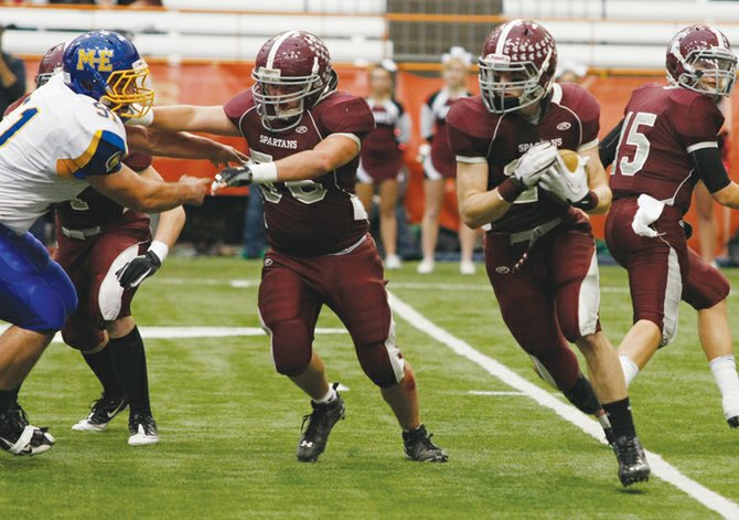 Burnt Hills-Ballston Lake tailback Thomas Ruppel (24) looks for running room during last Fridays Class A state final against Maine-Endwell at Syracuse Universitys Carrier Dome.