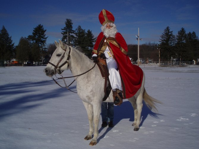Sinterklaas rides into Schuylerville each year on his white horse to bring gifts to the town's children in celebration of St. Nicholaas Day. (submitted photo)
