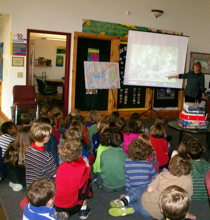 Local resident Carol Kurto shows the sutdents of Saratoga Independent School a presentation about the devestation in Schoharie County from Tropical Storm Irene.