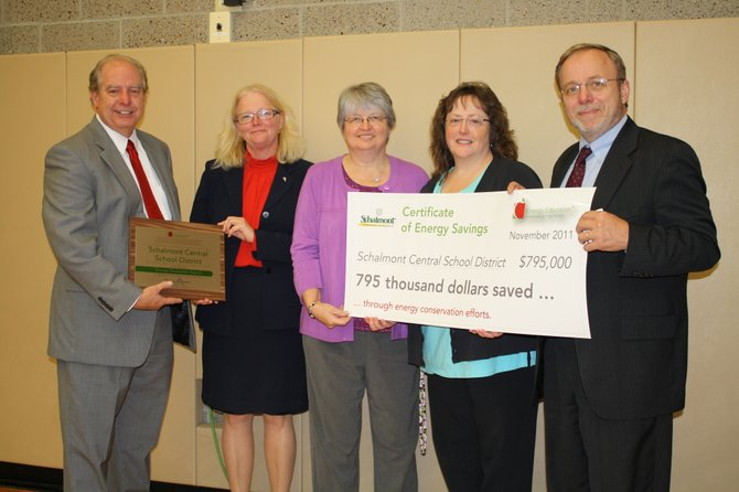 Schalmont officials accepted the Energy Pacesetter Award on Monday, Nov. 14. From left, Energy Education Vice President for Marketing Jim Galletly, Superintendent Valerie Kelsey, Board President Sandra Beloncik, District Energy Specialist Terri McCreadie and Business Administrator Mark Kellet.