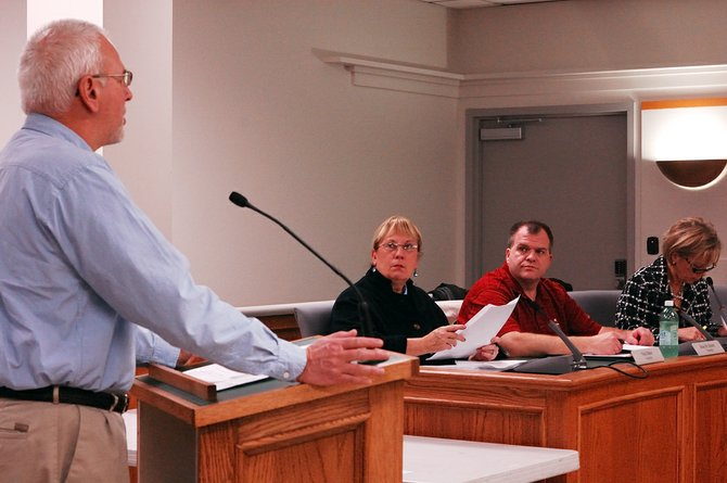 Vicki Baker, center, participates in her second-to-last regular meeting of the DeWitt Town Board.
