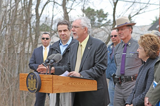 Moriah Supervisor Tom Scozzafava welcomed Gov. Andrew Cuomo to Moriah last spring. Cuomo came to see the damage caused by April flooding in the community.