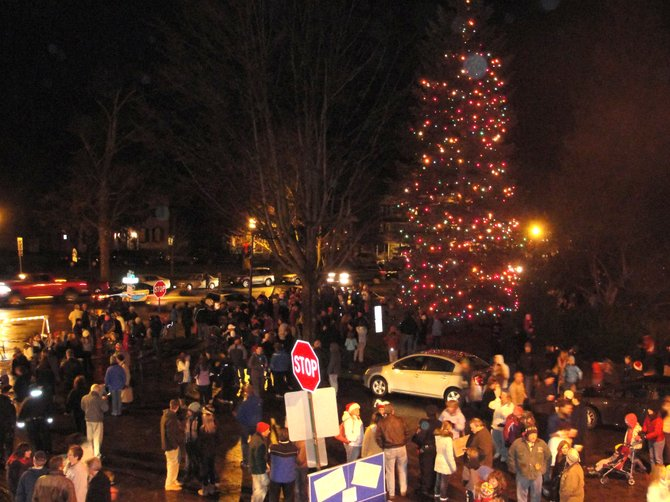 Residents stroll Albany Street after the Village Tree, a 70-foot-tall Norway Spruce, was illumniated by Mayor Wheeler and Santa Claus during the 34th Annual Christmas Walk, Dec. 2.