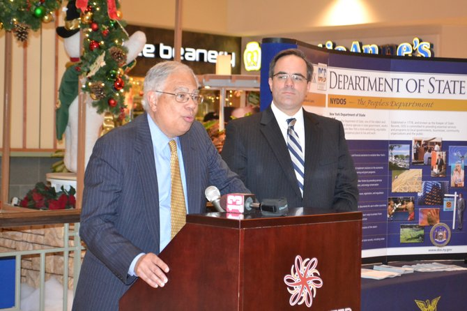 Secretary of State Cesar A. Perales (left) and Executive Vice President of the Retail Council of New York Ted Potrikus (right) gave shoppers a brief rundown of safe shopping practices for the holiday season, including prevention of identity theft, toy safety and product recalls, budgeting tips and more.