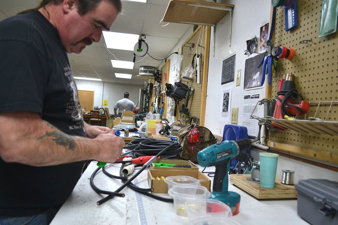 Electrical shop worker Kevin Keath puts the finishing touches on electrical cable at Creative Stage Lighting. The company is looking to expand and considering its options.