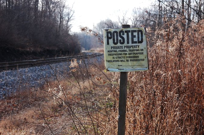 A posted sign warns hunters that they are encroaching private property.