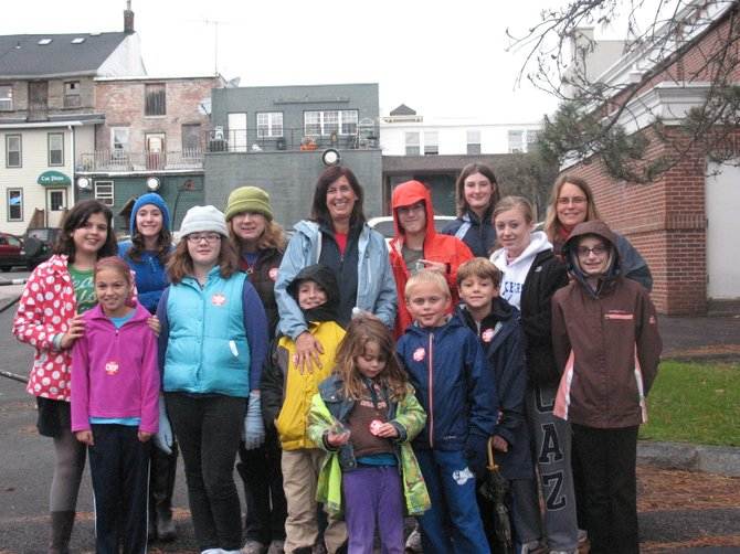 Members of Cazenovia's Lincklaen Shamrocks 4-H group gather for a group photo after completing the Cazenovia CROP Walk, Oct. 16.