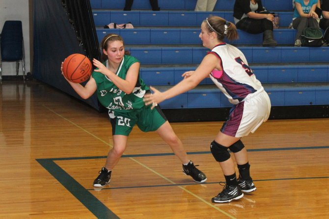 Cailtin Kozak of Chazy tries to get a pass by Westport&#39;s Brendee Russell