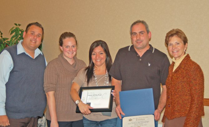 Best Western Plus Ticonderoga Inn & Suites, represented by owners Mike and Jovana Stipo and Sales & Marketing Director Allison Kaupelis, was named 2011 Business of the Year at the Ticonderoga Area Chamber of Commerce's annual dinner. From left are Matthew Courtright, chamber executive director, Kaupelis, Jovana Stipo, Mike Stipo and Assemblywoman Teresa Sayward.