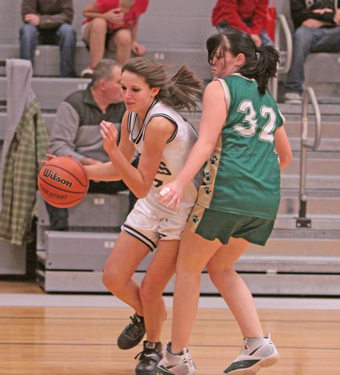 Crown Point opened the Mountain and Valley Athletic Conference girls basketball season with a 55-21 victory over Johnsburg Dec. 5. Marissa Titus led the Panthers with 21 points, 13 rebounds and five assists. Amanda Wolf added 16 points, 19 rebounds and four blocks for the victors.