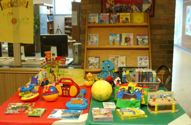 Students in Mrs. Phelan's second grade class at Westmere Elementary School in Guilderland raised money for a Schoharie County school hit hard by Tropical Storm Irene. The idea for the gently used toy and game sale came from Phelan, students and a contact with the Middleburgh Central School, which sustained severe damage to its wood shop and technology center.