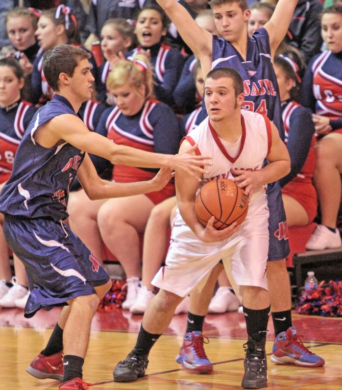 Moriah's Jim Curran is double-teamed by AuSable Valley defenders in Champlain Valley Athletic Conference action.  AVCS won, 64-34.