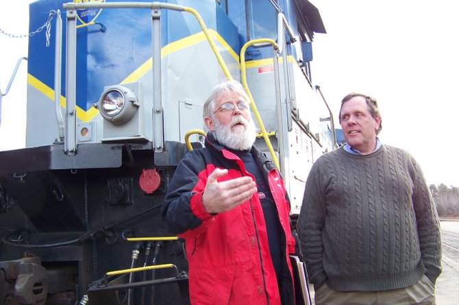 At a recent event in Saratoga announcing the Dec. 30 startup of Snow Train service to North Creek, Mike Bowers of barVino in North Creek (left) talks about how the Saratoga-North Creek Railway has revitalized tourism and commerce in his town. Ed Ellis of the railway (right) said the rail line to Tahawus was likely to open in 2012 as he talked about how rail service to North Creek has far exceeded expectations to date.