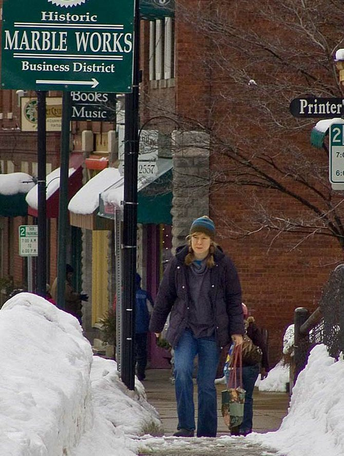 Downtown Middlebury Improvement District tax revenue may be used to fund several projects including wireless access downtown, a parking study, and an effort to convert historic streetlights in the downtown from metal halide to LED fixtures.
