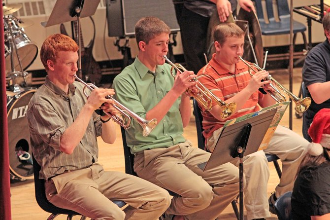 Riley Chapman, Anthony DuShane and  Dale Quesnel perform with the Sentinel Big band during the annual Ticonderoga High School winter concert.