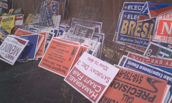 Signs collected from town property are piled up at the town's highway department in late November. (submitted photo)