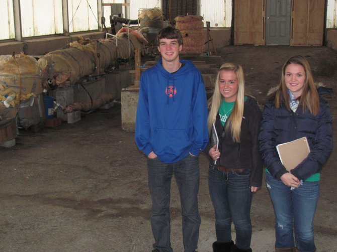 East Syracuse-Minoa seniors, from left, Kyle Scanlon, Danielle Hobb and Mallory Petterelli, stand in front of the anaerobic digester at the village of Minoa Waste Water Treatment Facility.