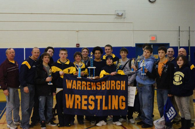 Warrensburg wrestlers celebrate with their trophies following their victory Saturday Dec. 17 when they won the 16-team Granville tournament.