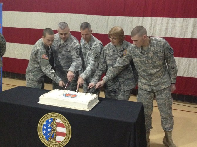 Five National Guardsmen with Dec. 13 birthdays cut the cake at a birthday ceremony for the 375th birthday of the National Guard on Tuesday, Dec. 13.