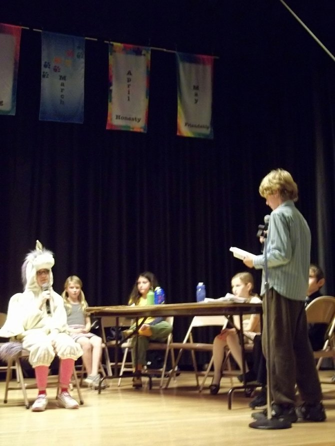 Yasmin the unicorn, played by Ballston Scholar Caitlin Doyle, is questioned by the prosecution on if she witnessed Goldilocks enter the three bears home. 