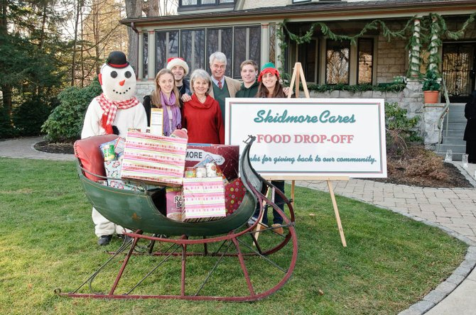 The Skidmore Cares sleigh filled with donations outside of the President's house.
