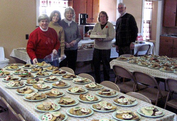 North River Church members, Anita Abrams, Jen Davis, Amy Sebattis, Sandy and Jim Cashman make plates of cookies for inclusion in the Christmas Baskets distributed by the Johnsburg Food Pantry in December 2011. All of the cookies were made and donated by members of the Johnsburg community.