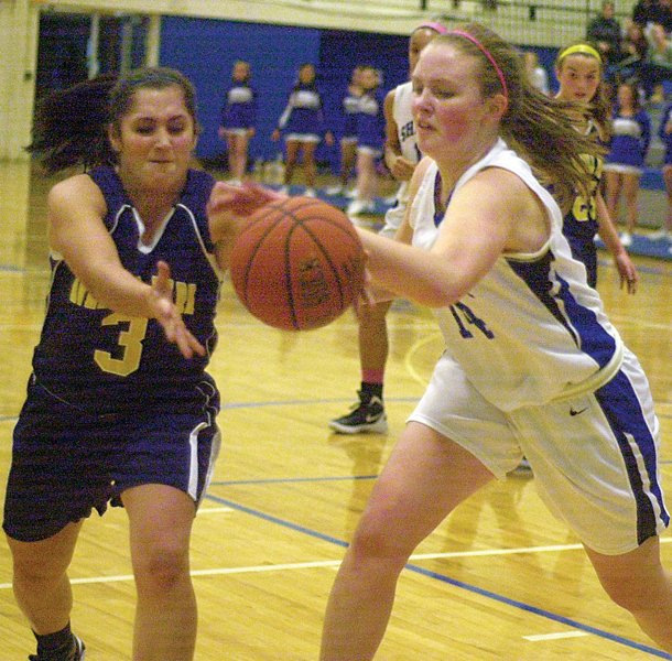Shakers Lauren Woods, right, knocks the ball away from an Averill Park player during Fridays Suburban Council game.