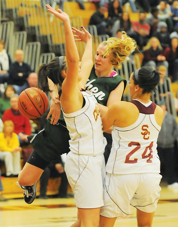 Shenendehowas Emily Weber, center, is fouled as she attempts a shot during Tuesdays Suburban Council game at Colonie.