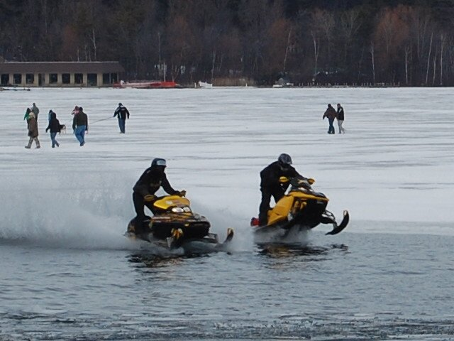 A pair of snowmobile riders skim across Lake George during 2010 during the Lake George Winter Carnival, which annually attracts hundreds of sled enthusiasts in February. The Lake George Village Board voted Dec. 19 to establish snowmobile parking at the former Gaslight Village site during all the winter months so more snowmobilers will be attracted to downtown Lake George.