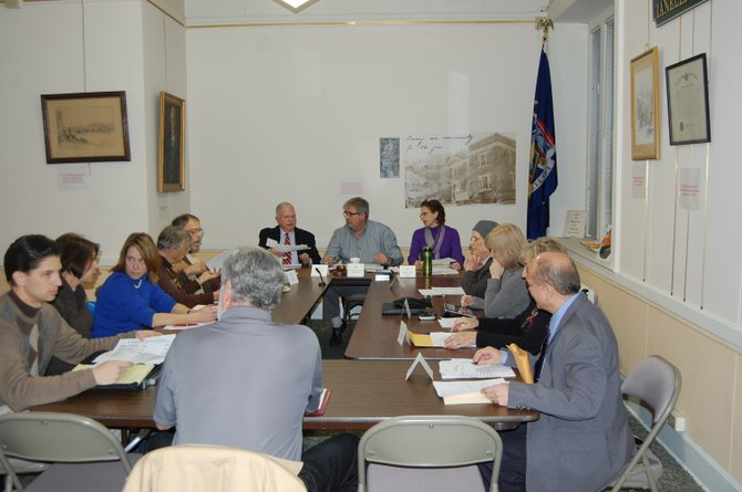 Plattsburgh Public Library's Board of Directors discuss a plan that could save four positions and increase the library's financial stability.