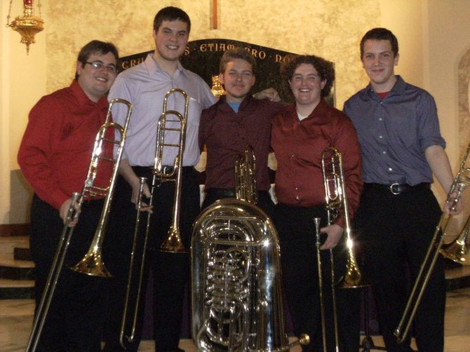 Megan Walls, second from right, of Ticonderoga, a graduate music student at Illinois State University, organized a concert by the  Snow Bones Trombone Ensemble to benefit the Moriah Central School women's chorus, which is raising money for a trip and performance at Disney World this spring.