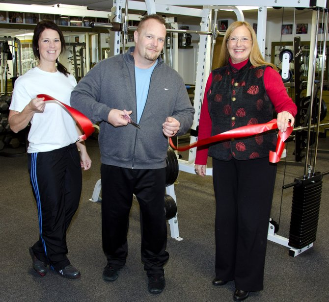 Marji Graf with owners Dennis and Stephanie Kopacz of Sculpted Physiques in Chester.