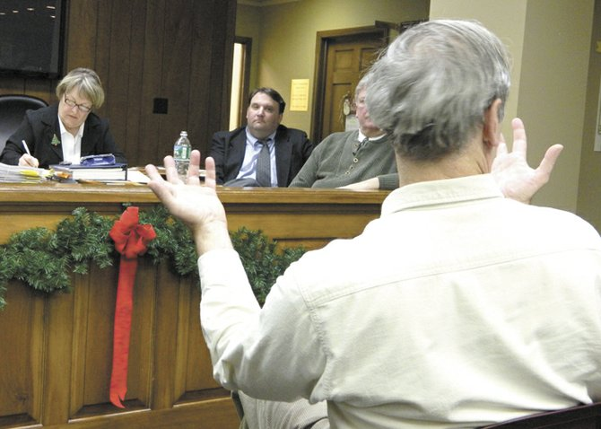 """Skaneateles resident Bill Hecht, gesturing at right, asks Town Attorney Patrick Sardino, center, about the strength of the town's hydrofracking moratorium if it were challenged in court. """"We're on a strong footing,"""" Sardino responded. Town Clerk Janet Aaron, left, takes notes while Town Councilor  Rick Keyes, second from right, listens during the public hearing."""