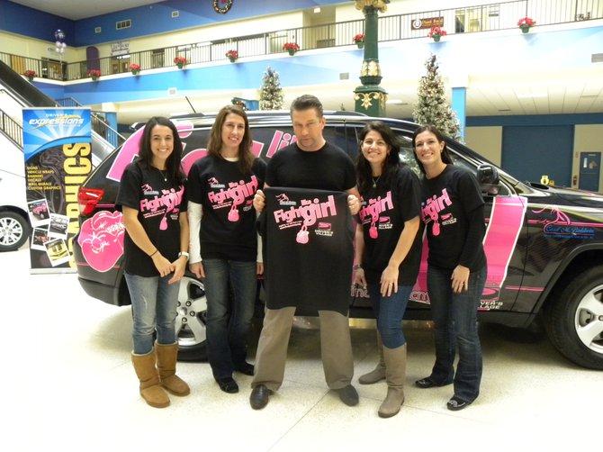 "Lining up to ""fight"" breast cancer after the Dec. 27 unveiling are, from left, Christina Bregou, Christina Bregou Burtis, Stephen Baldwin, Jackie Bregou Conover and Liz Bregou."